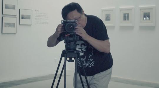 一个投出几百份简历被拒的中国摄影师,20年后成了全球图片大亨